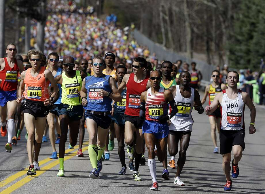 Runners compete in the 118th Boston Marathon Monday, April 21, 2014 in Hopkinton, Mass. (AP Photo/Steven Senne) Photo: Steven Senne, Associated Press