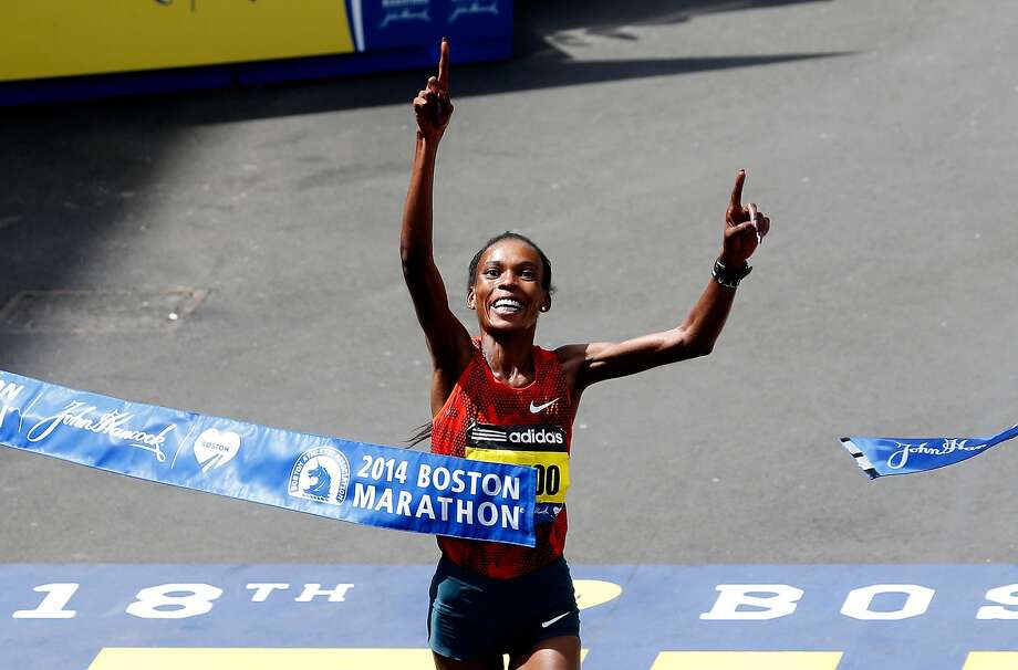 Rita Jeptoo of Kenya crosses the finish line to win the 118th Boston Marathon on April 21, 2014 in Boston, Massachusetts. Photo: Jim Rogash, Getty Images