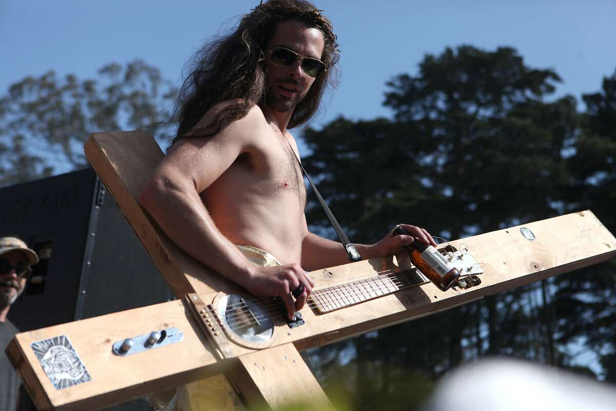 A Hunky Jesus competitor plays his guitar cross while drinking a beer during the Hunky Jesus contest held at the 35th annual Easter Celebration put on by the Sisters of Perpetual Indulgence in Golden Gate Park, San Francisco, Calif. on April 20, 2014.
