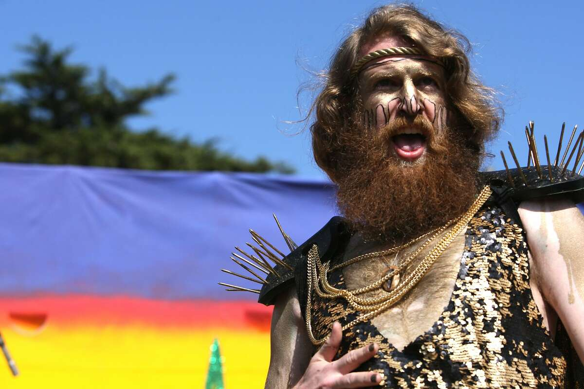 Competing for the Hunky Jesus, one contender encourages the crowd to roar for him during the Hunky Jesus contest at the 35th annual Easter Celebration put on by the Sisters of Perpetual Indulgence in Golden Gate Park, San Francisco, Calif. on April 20, 2014.