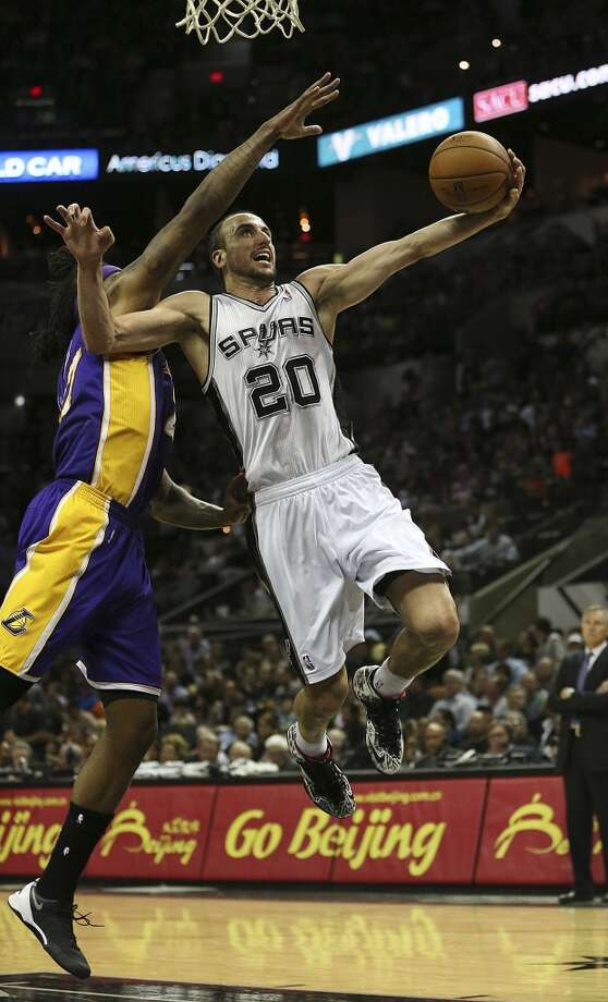 San Antonio Spurs' Manu Ginobili head to the goal as Los Angeles Lakers' Jordan Hill defends during the second half at the AT&T Center, Wednesday, April 16, 2014. The Lakers won 113-100. Photo: Jerry Lara, San Antonio Express-News