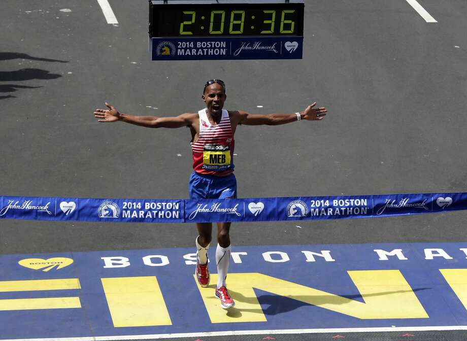 Meb Keflezighi, of San Diego, Calif., celebrates as he crosses the finish line to win the 118th Boston Marathon, Monday, April 21, 2014, in Boston.  Photo: Charles Krupa, Associated Press