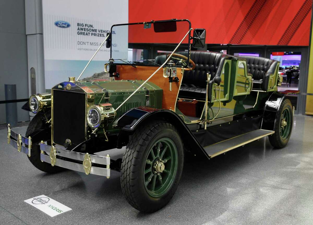 A prototype of an electric carriage is displayed at the New York International Auto Show in New York, Thursday, April 17, 2014. A prototype of the old-timey electric cars that Mayor Bill de Blasio would like to take the place of horse-drawn carriages on New York City streets will be unveiled at the New York Auto Show on Thursday. (AP Photo/Seth Wenig) ORG XMIT: NYSW112