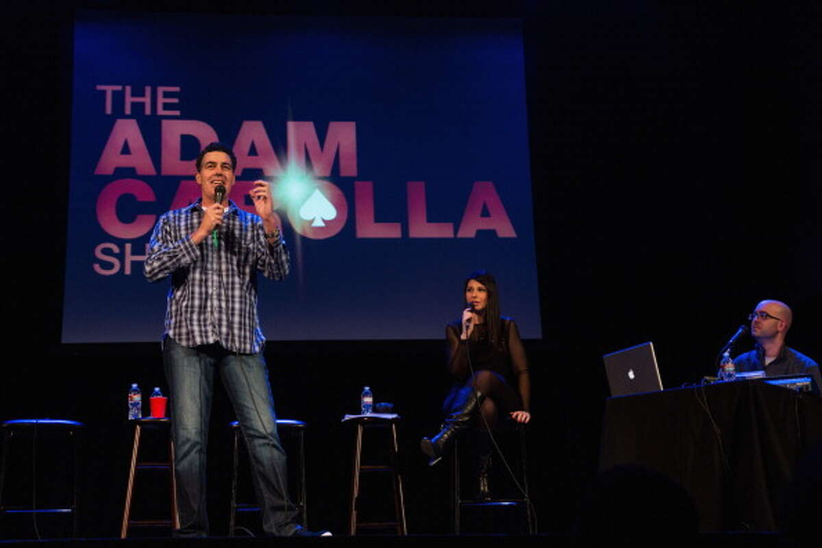 """America's Funniest Cities10. Seattle - """"The Home of Improv""""The top 10 cities each received a tagline to represent its brand of humor. Pictured: Comedian Adam Carolla, Alison Rosen and Bald Bryan speak while recording a podcast on stage at the Neptune Theater on Oct. 12, 2013 in Seattle."""