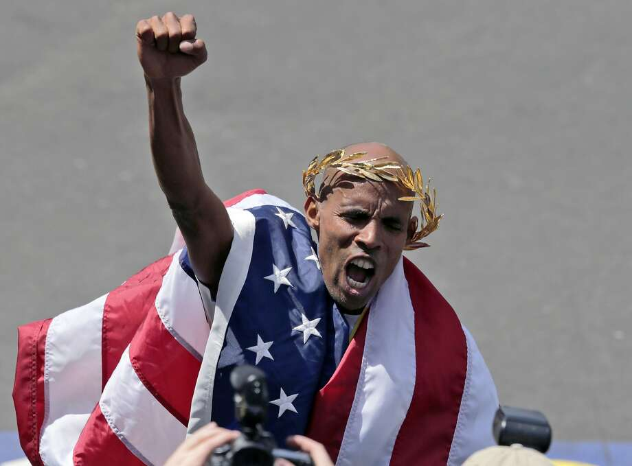 Meb Keflezighi, of San Diego, Calif., celebrates his victory in the 118th Boston Marathon Monday, April 21, 2014 in Boston. (AP Photo/Charles Krupa) Photo: Charles Krupa, Associated Press