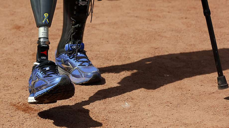 "A ""Boston Strong"" sticker is seen on the prosthetic leg of Boston Marathon bombing survivor Marc Fucarile after he threw out the ceremonial first pitch before the baseball game between the Boston Red Sox and the Baltimore Orioles at Fenway Park in Boston Monday, April 21, 2014. Photo: Winslow Townson, Associated Press"