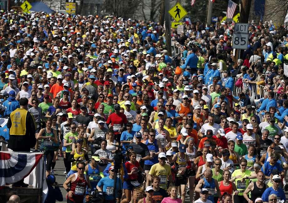 Runners compete near the start of the 118th Boston Marathon Monday, April 21, 2014 in Hopkinton, Mass. Photo: Michael Dwyer, Associated Press