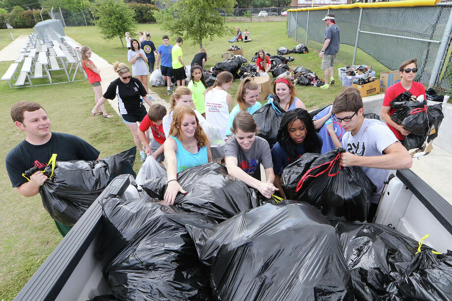 "April 2014: Churchill High School Parliament students load bags of shoes they collected in their ""Kicks for Kindness"" campaign, their attempt to break the Guiness Book of World Records record for longest chain of shoes.  The students collected more than 13,000 pairs of shoes in the effort, donating them to Arms of Hope, though they fell well short of the record of 26,000. Photo: MARVIN PFEIFFER, Marvin Pfeiffer/ EN Communities / Express-News 2014"