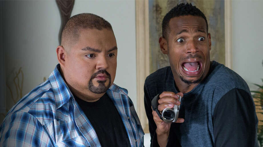 "Open Road Films Marlon Wayans, right and Gabriel Iglesias react to the goings on in ""A Haunted House 2."""