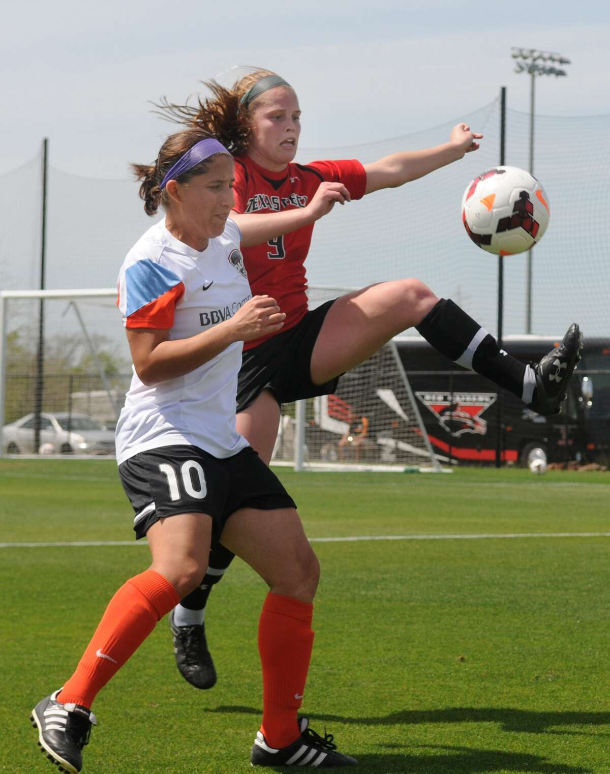 Houston Dash's Teresa Noyola (#10) works the ball during the team's scrimmage with Texas Tech University at Houston Sports Park.