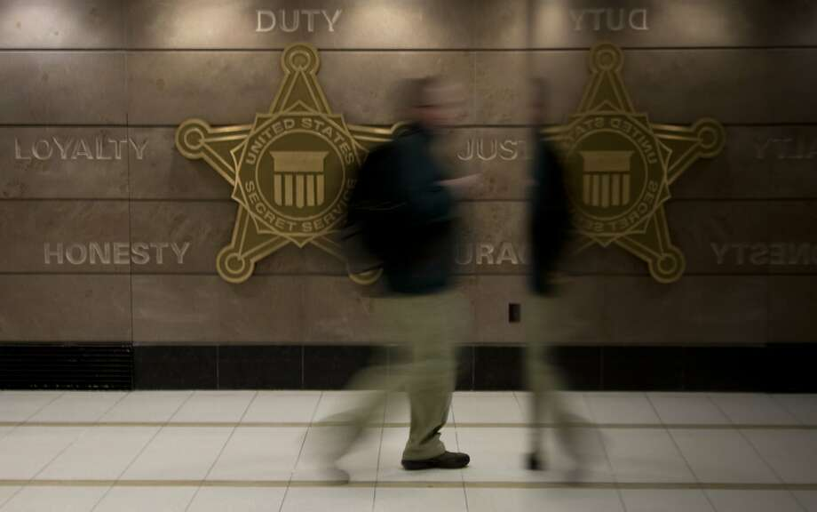 In this Feb. 20, 2014 photo, a man walks through a hall at Secret Service offices  in Washington. Secret Service investigators say it could take years to identify the hackers who breached Target's computer systems in December _and even longer to bring them to justice. (AP Photo/Carolyn Kaster) Photo: Carolyn Kaster, Associated Press