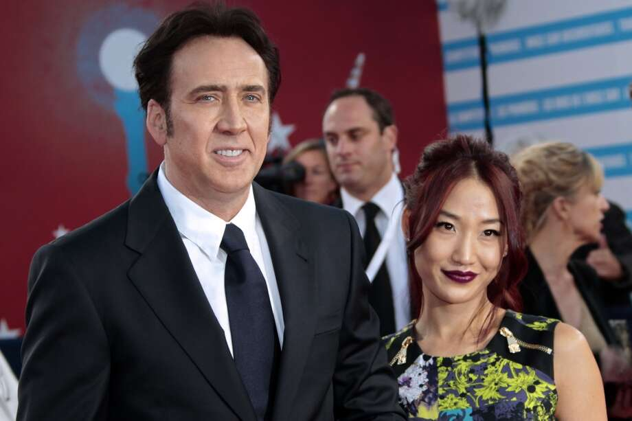 """Nicolas Cage and Alice Kim(Age difference: 20 years) When she was born in 1984, he had roles in three movies: """"Racing with the Moon,"""" """"The Cotton Club"""" and """"Birdy."""" Photo: CHARLY TRIBALLEAU, AFP/Getty Images"""