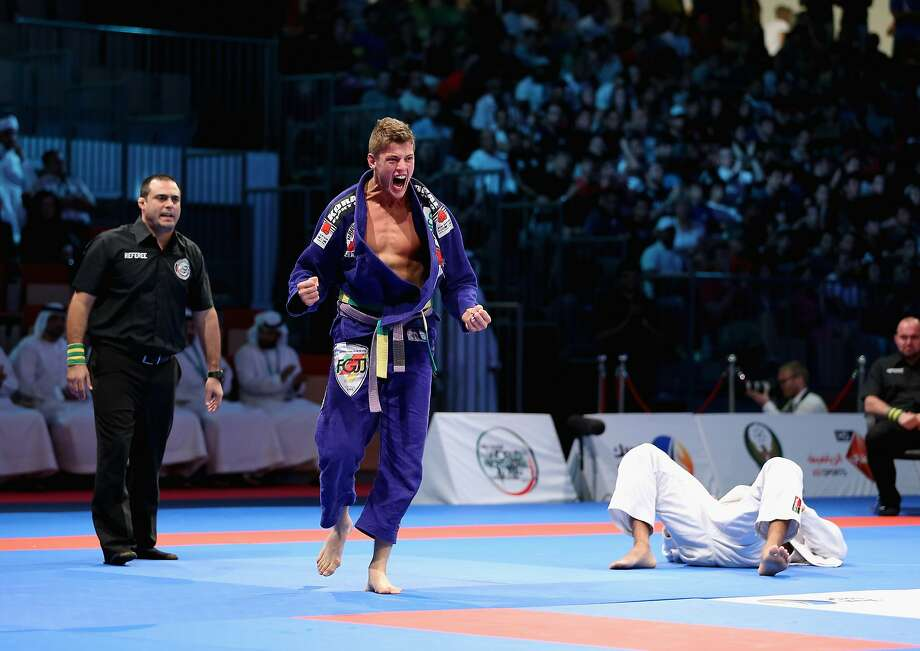 The knockdown:Nicholas Meregali of Brazil exults after flattening his countryman, Mahamed Santos, in the men's purple belt open weight finals during the Abu Dhabi World Professional Jiu-Jitsu 