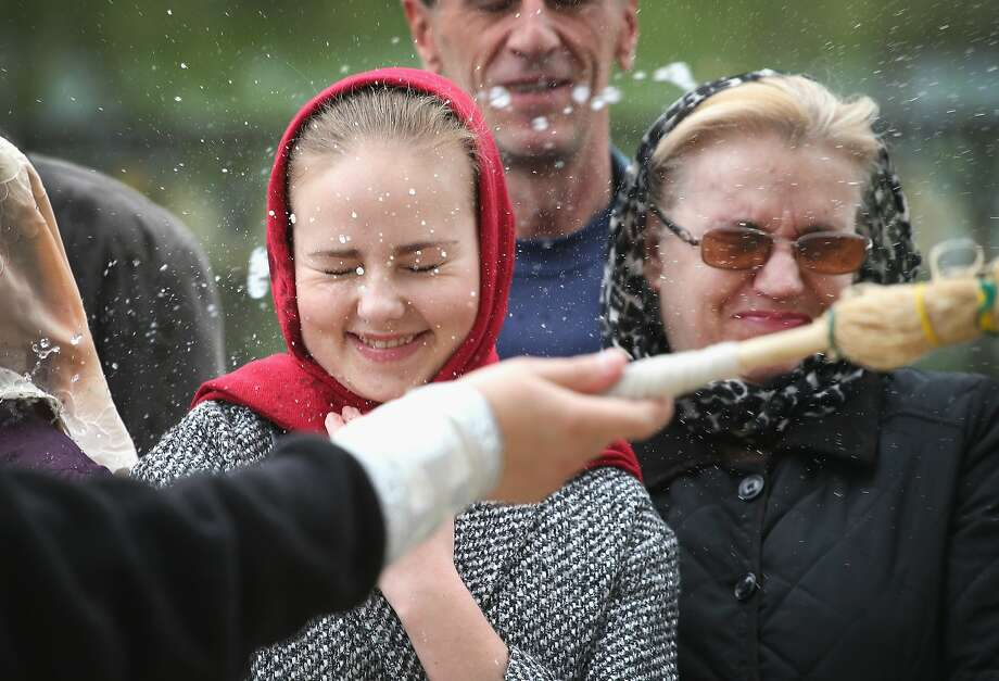 Blessed are the moist: Worshippers are splashed with holy water outside Holy Transfiguration Cathedral in Donetsk, Ukraine. Photo: Scott Olson, Getty Images