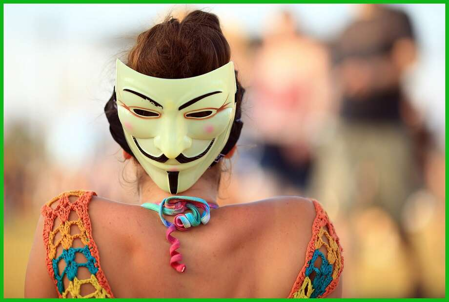 Eyes in the back of her head:A Guy Fawkes mask makes an appearance at the Coachella Valley Music & Arts Festival in   Indio, Calif. Photo: Christopher Polk, Getty Images For Coachella