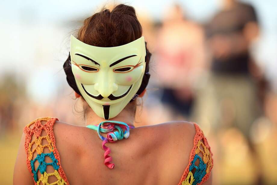 Eyes in the back of her head:A Guy Fawkes mask makes an appearance at the Coachella Valley Music & Arts Festival in 