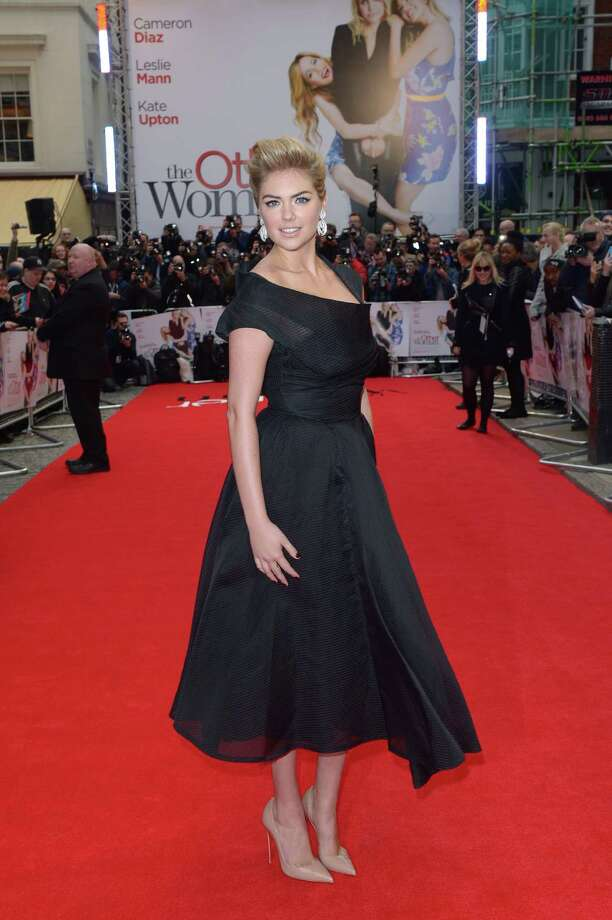 U.S. actress Kate Upton poses for photographers as she arrives for the gala screening of The Other Woman in London, Wednesday April 2, 2014. (Photo by Jon Furniss/Invision/AP) Photo: Jon Furniss, Multiple / AP2014