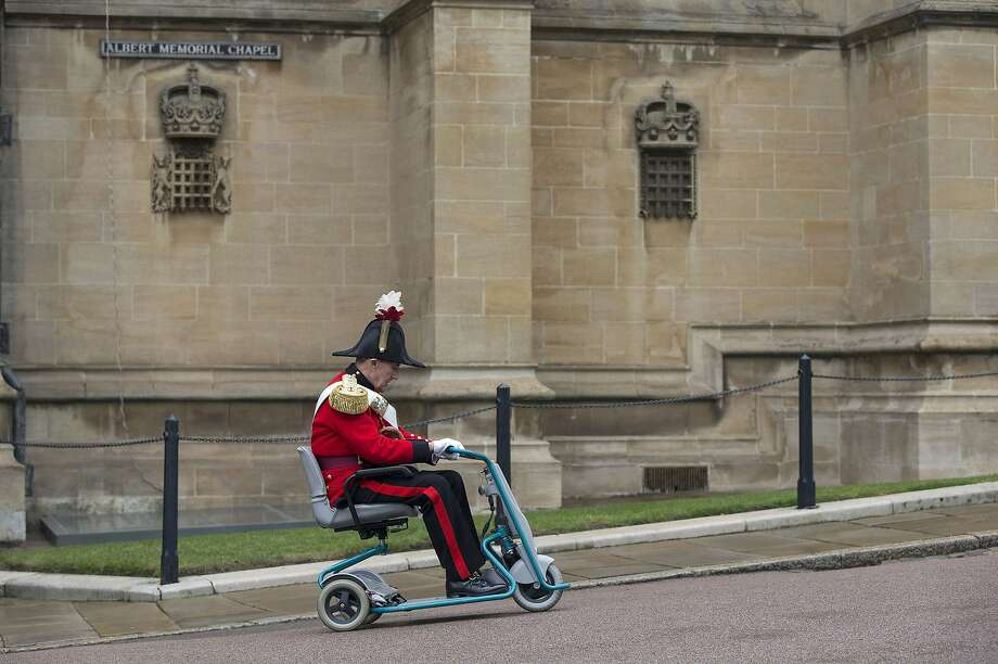 Mounted knight:A Military Knight of Windsor (a retired British officer) scoots to his next appointment after attending Easter Matins at St.   George's Chapel in Windsor Castle, west of London. Photo: Oli Scarff, AFP/Getty Images