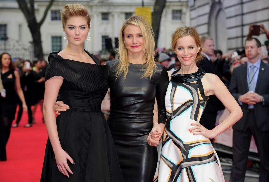 U.S actresses Kate Upton, left, Cameron Diaz and Leslie Mann, right, arrive for the UK premiere of The Other Woman at a central London cinema, London, Wednesday April 2, 2014. (Photo by Jonathan Short/Invision/AP) Photo: Jonathan Short, Multiple / AP2014