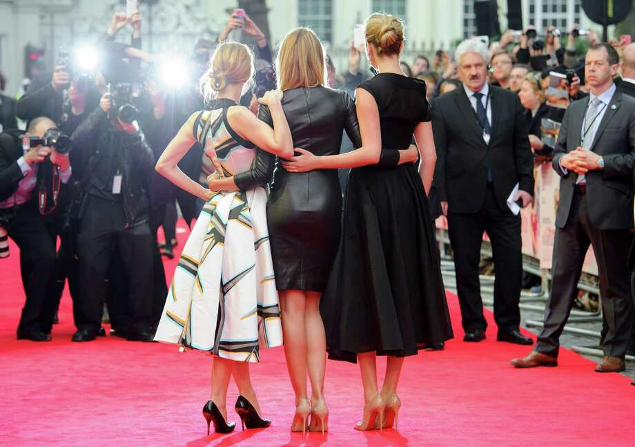 U.S actresses Kate Upton, right, Cameron Diaz and Leslie Mann, left, arrive for the UK premiere of The Other Woman at a central London cinema, London, Wednesday April 2, 2014. (Photo by Jonathan Short/Invision/AP) Photo: Jonathan Short, Multiple / AP2014