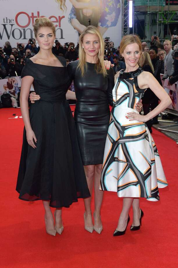 From Left, actresses Kate Upton, Cameron Diaz and Leslie Mann pose for photographers as they arrive for the gala screening of The Other Woman in London, Wednesday April 2, 2014. (Photo by Jon Furniss/Invision/AP) Photo: Jon Furniss, Multiple / AP2014