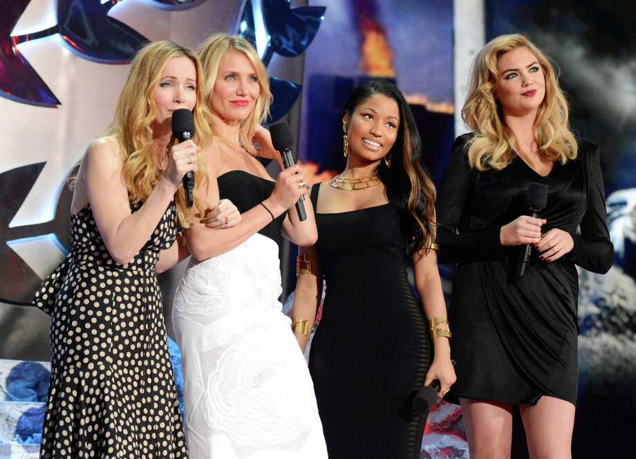 (L-R) Actress Leslie Mann, actress Cameron Diaz, actress-singer Nicki Minaj, and actress-model Kate Upton speak onstage at the 2014 MTV Movie Awards at Nokia Theatre L.A. Live on April 13, 2014 in Los Angeles, California.  (Photo by Kevin Mazur/WireImage) Photo: Kevin Mazur, Multiple / 2014 Kevin Mazur