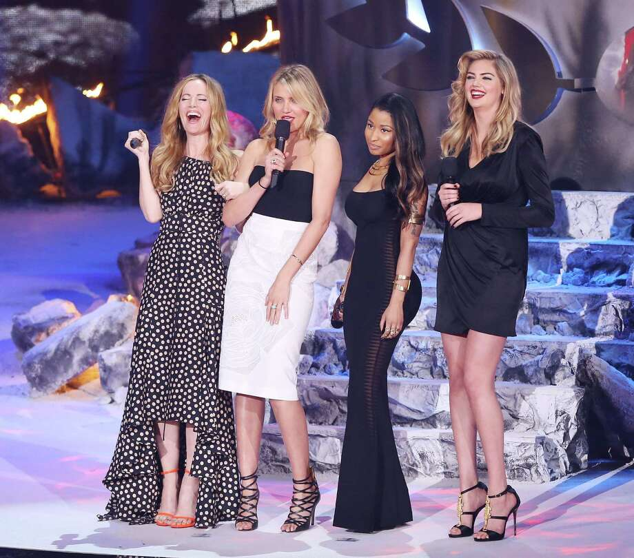 (L-R) Actress Leslie Mann, actress Cameron Diaz, recording artist Nicki Minaj, and model/actress Kate Upton speak onstage during the 2014 MTV Movie Awards held at Nokia Theatre L.A. Live on April 13, 2014 in Los Angeles, California.  (Photo by Michael Tran/FilmMagic) Photo: Michael Tran, Multiple / 2014 Michael Tran