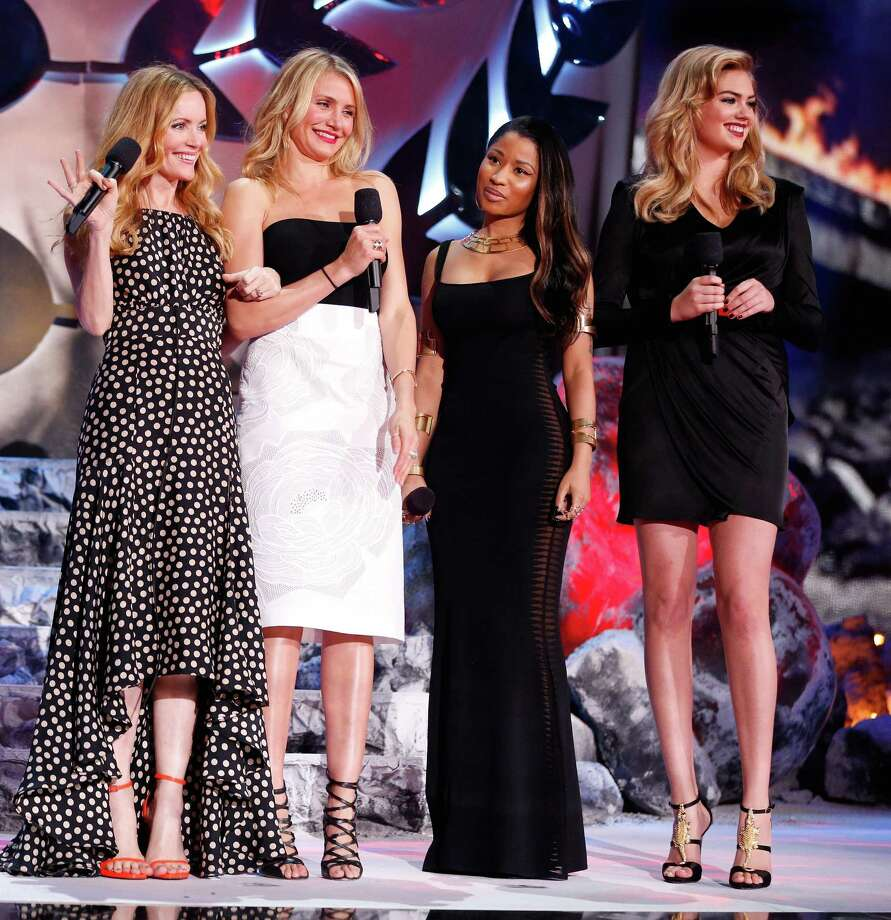 (L-R) Actress Leslie Mann, actress Cameron Diaz, recording artist Nicki Minaj, and model/actress Kate Upton speak onstage at the 2014 MTV Movie Awards at Nokia Theatre L.A. Live on April 13, 2014 in Los Angeles, California.  (Photo by Christopher Polk/Getty Images for MTV) Photo: Christopher Polk, Multiple / 2014 Getty Images