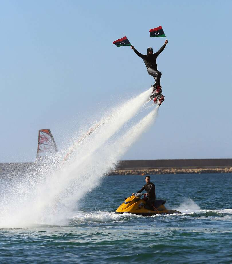 Libyan launch:During a local windsurfing competition in Tripoli, a Libyan promotes another form of sea   travel - water jetpack propulsion. Photo: Mahmud Turkia, AFP/Getty Images