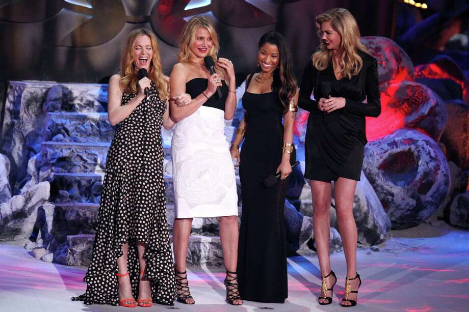 From left, Leslie Mann, Cameron Diaz, Nicki Minaj and Kate Upton present the award for best male performance on stage at the MTV Movie Awards on Sunday, April 13, 2014, at Nokia Theatre in Los Angeles. (Photo by Matt Sayles/Invision/AP) Photo: Matt Sayles, Multiple / AP2014
