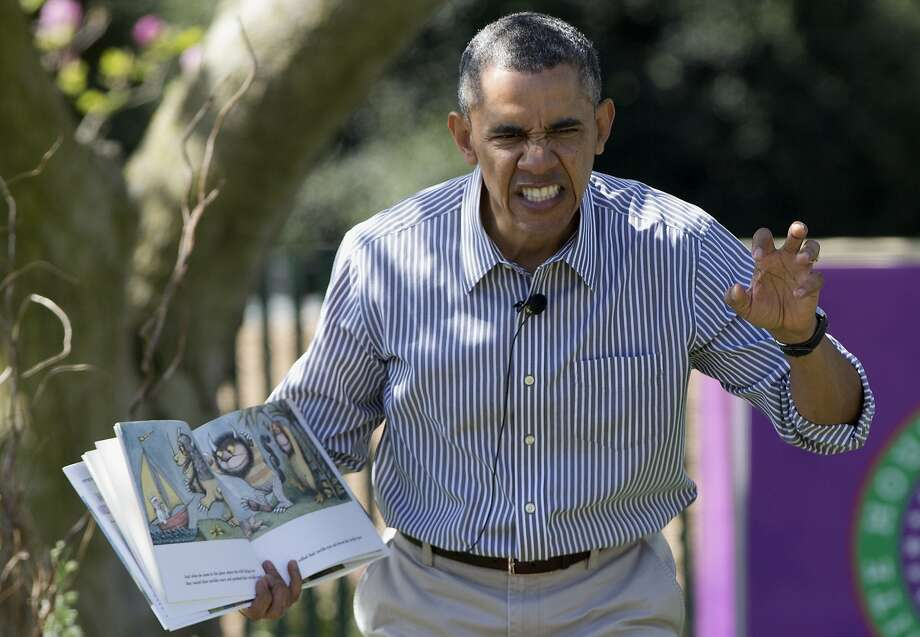 "That's no ordinary rabbit ... President Obama reads ""Where the Wild Things Are"" by Maurice Sendak to children during the White House Easter Egg Roll. Photo: Carolyn Kaster, Associated Press"