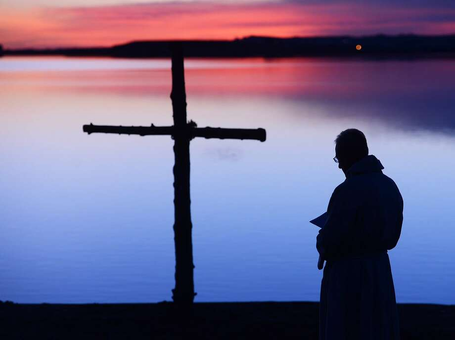 Easter early riser:The Rev. Mark Twietmeyer of Trinity Lutheran Church stands before giving the sermon for the Easter Sunrise Service in Boulder, Colo. Photo: Cliff Grassmick, Associated Press