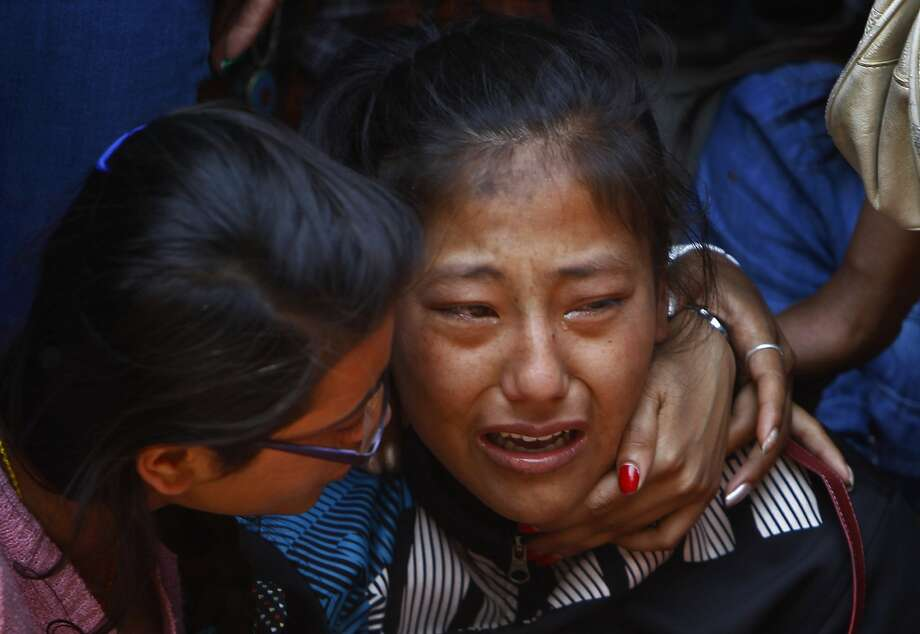 A relative of one of the Nepalese climbers killed in an avalanche on Mount Everest, cries during the funeral ceremony in Katmandu, Nepal, Monday, April 21, 2014. Buddhist monks cremated the remains of Sherpa guides who were buried in the deadliest avalanche ever recorded on Mount Everest, a disaster that has prompted calls for a climbing boycott by Nepal's ethnic Sherpa community. The avalanche killed at least 13 Sherpas. Three other Sherpas remain missing and are presumed dead. (AP Photo/Niranjan Shrestha) Photo: Niranjan Shrestha, Associated Press