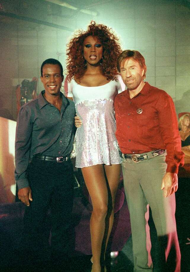Trivette (Clarence Gilyard, left) must befriend a nightclub owner (guest star RuPaul, center) in order to stop plans for a royal jewel heist and the murder of Ranger Cordell Walker (Chuck Norris, right), on WALKER, TEXAS RANGER. Photo: TIM BOOLE, CBS