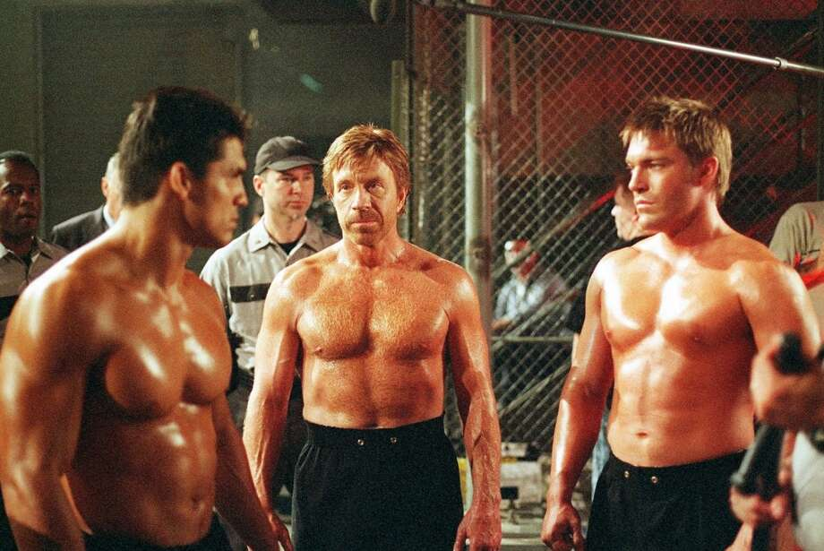 Trivette (Clarence Gilyard, background, left) watches on as Walker (Chuck Norris, center) and Gage (Judson Mills, right) go undercover as convicts at a rough Arkansas maximum security prison to investigate guards who are staging and videotaping brutal fights between the prisoners. Photo: RICHARD TWAROG, CBS