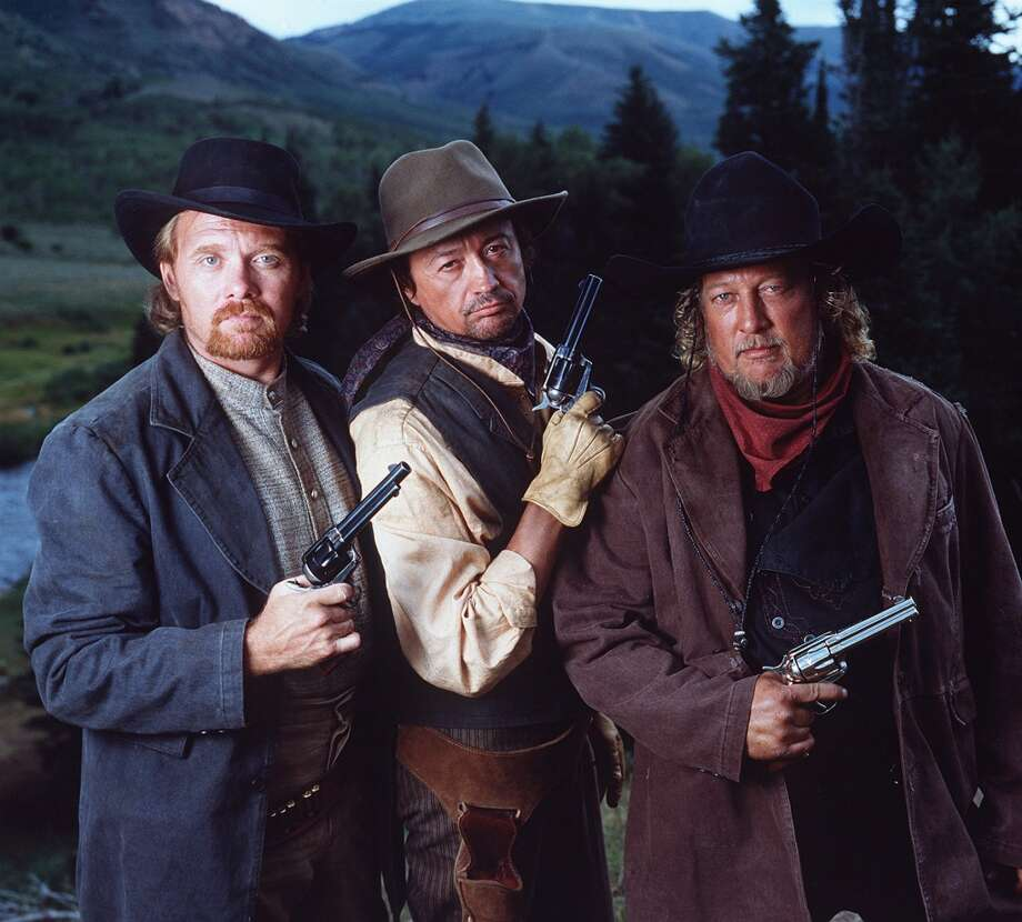 Country Music performers (from left)  Lee Roy Parnell , Mark Collie and John Anderson guest star as the Tarvin Brothers, a trio of bandits who attack Mormon settlers in the Utah Mountains of the 1800s. Photo: MONTY BRINTON, CBS