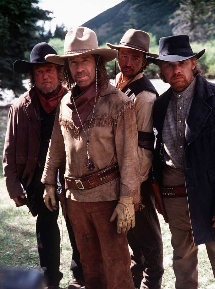 Country Music performers (from left) John Anderson, Mark Collie and Lee Roy Parnell guest star as the Tarvin Brothers, a trio of bandits whom Hayes Cooper (Chuck Norris, front) must capture in the Utah Mountains of the 1800s. This was from a special time-traveling episode of the series. Photo: MONTY BRINTON, CBS