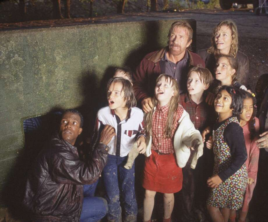 James Trivette (Clarence Gilyard, crouching down), Cordell Walker (Chuck Norris), Alex Cahill (Sheree J. Wilson), C.D. Parker (Noble Willingham, blue shirt), and the 'Kids in Government' remain sheltered as they watch a dangerous cyclone touch down. Photo: TIM BOOLE, CBS