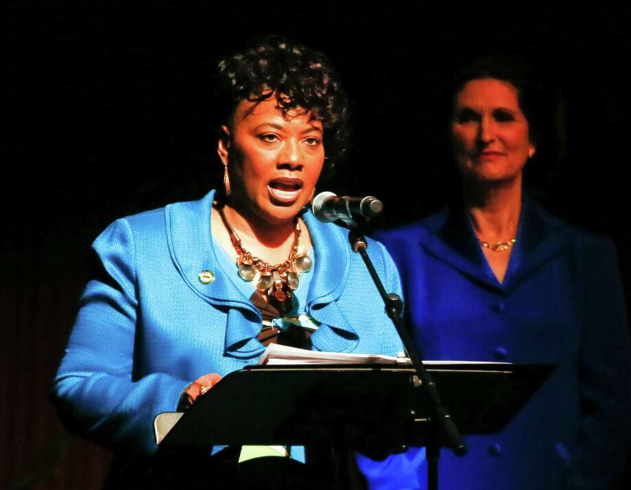 Bernice King, left, youngest daughter of Martin Luther King Jr., gives a reading during the Civil Rights Summit on Wednesday, April 9, 2014, in Austin, Texas. Lynda Johnson Robb, right, daughter of former President Lyndon Baines Johnson, also spoke. Photo: Jack Plunkett, Associated Press / FR59553 AP