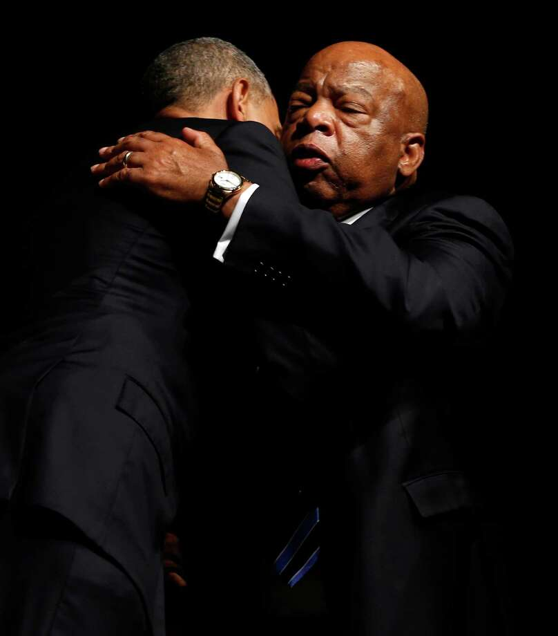 US Representative John Lewis hugs President Barack Obama after Obama's speech during the Civil Rights Summit at the LBJ Presidential Library in Austin, TX on Wednesday, April 10, 2014. President Barack Obama, celebrating a half-century of the Civil Rights Act, used the image of Lyndon B. Johnson to urge perseverance and courage to move civil rights forward. The nation's first black president spoke at the Civil Rights Summit, examining the 50th anniversary of Johnson's signing the seminal act ending segregation. Photo: Vernon Bryant, Associated Press / The Dallas Morning News