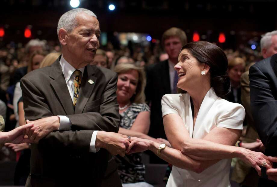 "Social activist Julian Bond, and leader in the American civil rights movement, and Luci Baines Johnson, the younger daughter of President Lyndon Baines Johnson, join hands as they sing ""We Shall Overcome"" before President Barack Obama spoke at the LBJ Presidential Library, Thursday, April 10, 2014, in Austin, Texas, during the Civil Rights Summit to commemorate the 50th anniversary of the signing of the Civil Rights Act. Photo: Carolyn Kaster, Associated Press / AP"