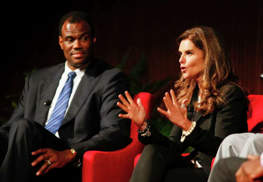 "Basketball hall of famer David Robinson, left, and Maria Schriver  take part in the ""Social Justice in the 21st Century"" panel during the Civil Rights Summit on Thursday, April 10, 2014, in Austin, Texas. Photo: Jack Plunkett, Associated Press / FR59553 AP"