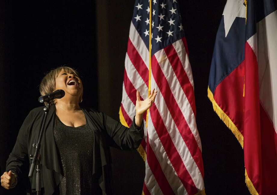 "Mabel Staples performs the song ""We Shall Overcome"" before President Barack Obama speaks on the third day of the Civil Rights Summit April 10, 2014 in Austin, Texas. The summit marks the 50th anniversary of the passing of the Civil Rights Act legislation. Photo: Pool, Getty Images / 2014 Getty Images"