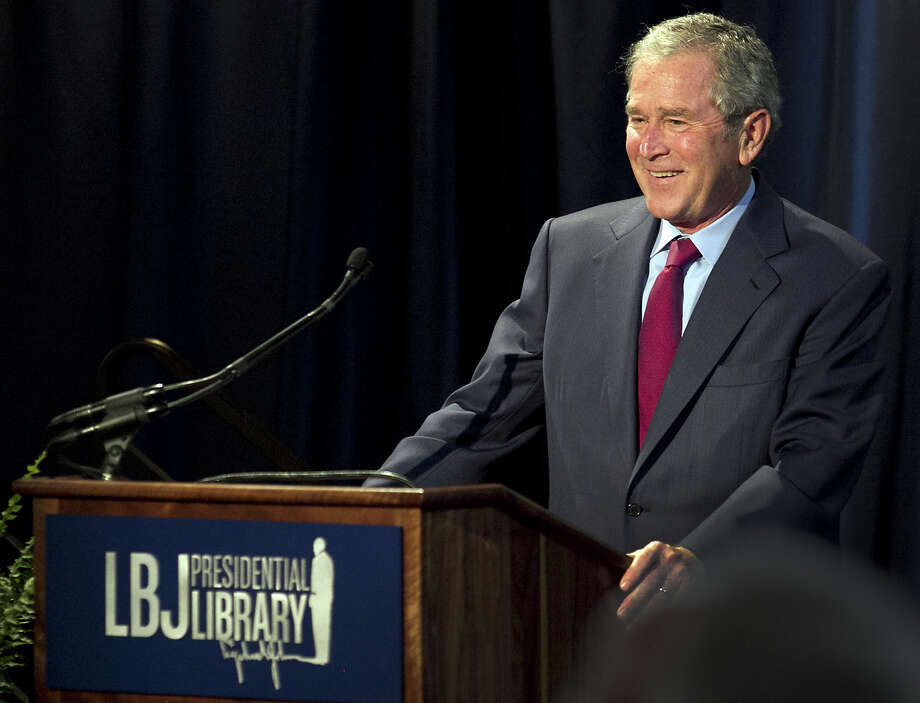 Former President George W. Bush addresses a private gathering in the LBJ Library Atrium, the last day of the Civil Rights Summit on April 10, 2014 in Austin, Texas.  The summit is marking the 50th anniversary of the passing of the Civil Rights Act legislation, with U.S. President Barack Obama making the keynote speech on April 10. Photo: Pool, Getty Images / 2014 Getty Images