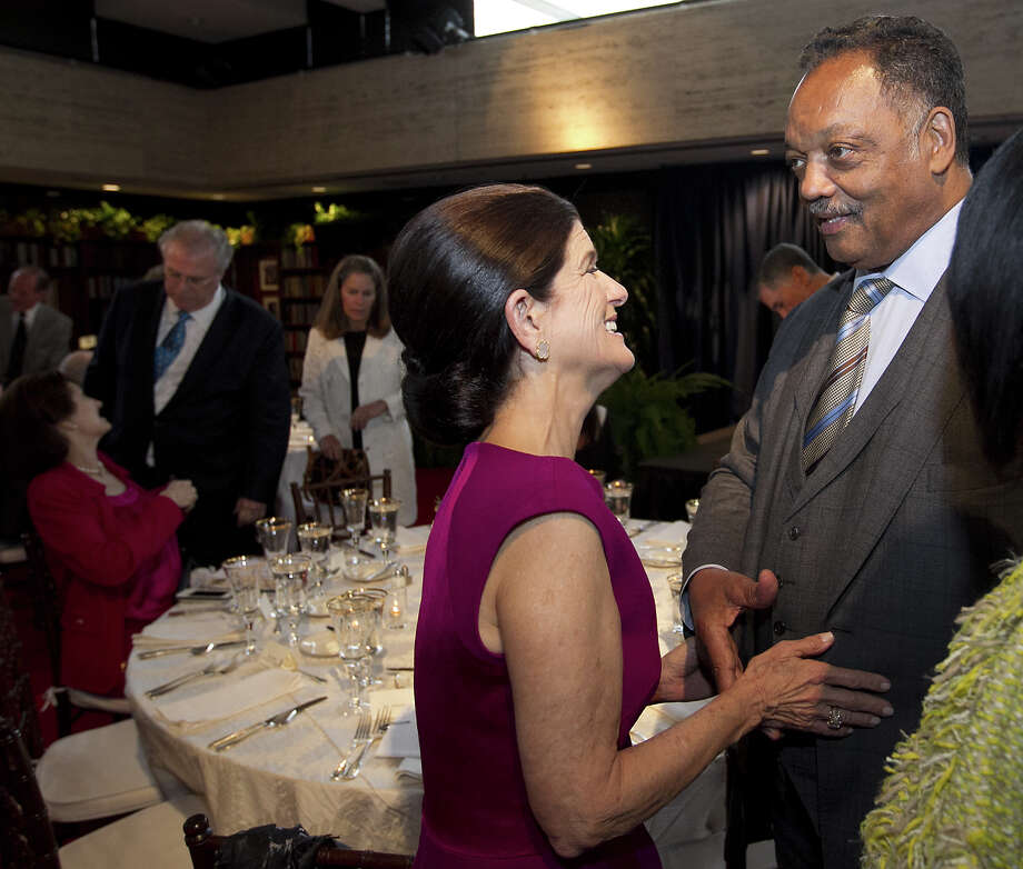 Luci Baines Johnson, daughter of LBJ, greets the Rev. Jesse Jackson before the special event where former President George W. Bush addresses a private gathering in the LBJ Library Atrium on April 10, 2014 in Austin, Texas.  The summit is marking the 50th anniversary of the passing of the Civil Rights Act legislation, with U.S. President Barack Obama making the keynote speech on April 10. Photo: Pool, Getty Images / 2014 Getty Images