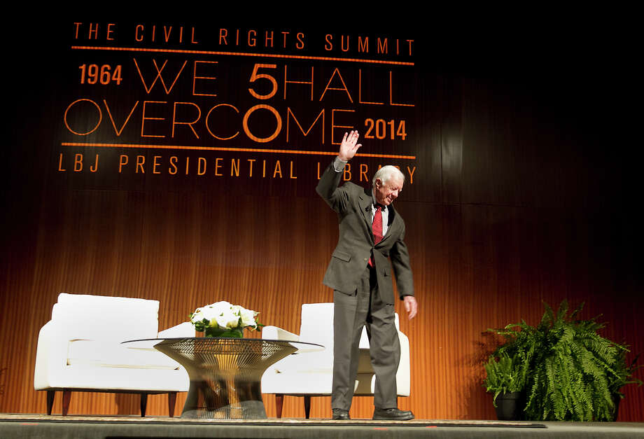The Civil Rights Summit at the LBJ Presidential Library in Austin, TX--Former President Jimmy Carter waves goodbye to the crowd after a he sat down for a conversation with Mark Updegrove, Director of the LBJ Presidential Library, on the first day of the Civil Rights Summit in Austin, TX. Tuesday evening April 8, 2014. Photo: Ralph Barrera, Photo Pool / POOL PHOTO