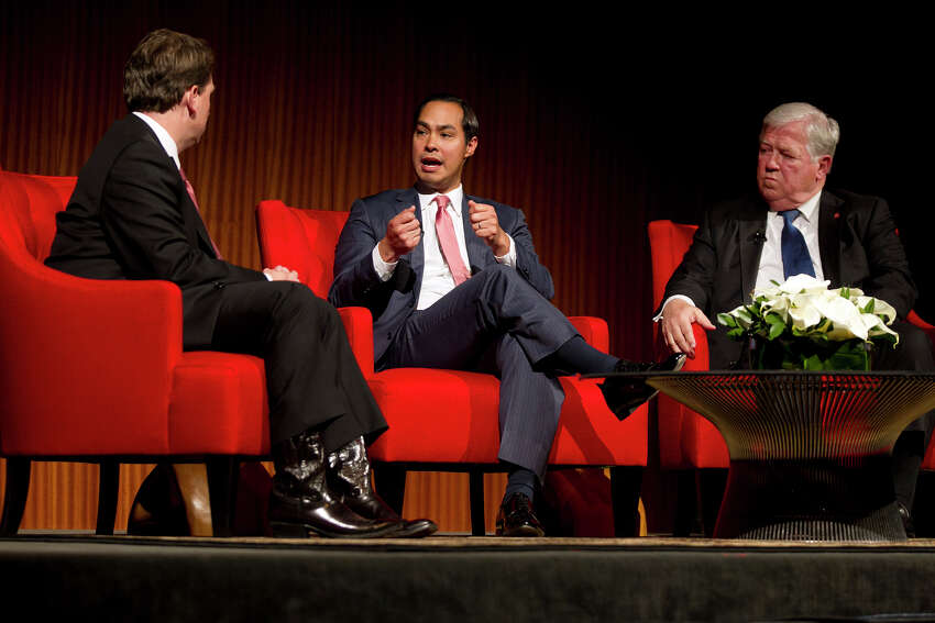 From left, Moderator Brian Sweany, Senior Executive Editor at Texas Monthly, left, and former Governor of Mississippi, Haley Barbour, far right, listen to the Mayor of San Antonio, Julian Castro speak during the 'Pathway to the American Dream: Immigration Policy in the 21st Century' panel at the Civil Rights Summit at the LBJ Presidential Library on the University of Texas campus in Austin, Tx., on Tuesday, April 8, 2014.