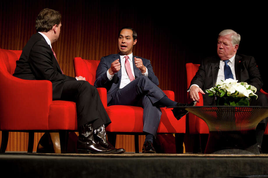 From left, Moderator Brian Sweany, Senior Executive Editor at Texas Monthly, left, and former Governor of Mississippi, Haley Barbour, far right, listen to the Mayor of San Antonio, Julian Castro speak during the 'Pathway to the American Dream: Immigration Policy in the 21st Century' panel at the Civil Rights Summit at the LBJ Presidential Library on the University of Texas campus in Austin, Tx., on Tuesday, April 8, 2014. Photo: Deborah Cannon, Photo Pool / POOL PHOTO