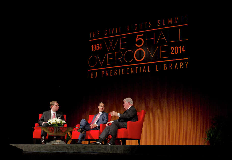 From left, Moderator Brian Sweany, Senior Executive Editor at Texas Monthly, left, and Mayor of San Antonio, Julian Castro, center, listens to former Governor of Mississippi, Haley Barbour, during the 'Pathway to the American Dream: Immigration Policy in the 21st Century' panel at the Civil Rights Summit at the LBJ Presidential Library on the University of Texas campus in Austin, Tx., on Tuesday, April 8, 2014. Photo: Dborah Cannon, Photo Pool / POOL PHOTO