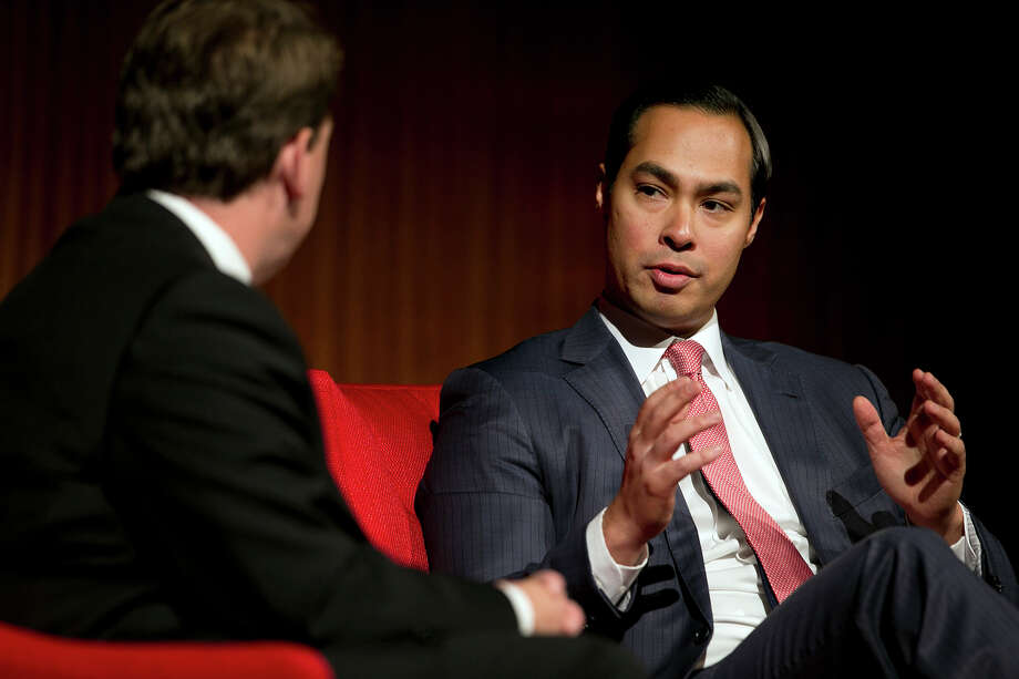 Moderator Brian Sweany, Senior Executive Editor at Texas Monthly, left, listens to a comment by Mayor of San Antonio, Julian Castro during the 'Pathway to the American Dream: Immigration Policy in the 21st Century' panel at the Civil Rights Summit at the LBJ Presidential Library on the University of Texas campus in Austin, Tx., on Tuesday, April 8, 2014. Photo: Dborah Cannon, Photo Pool / POOL PHOTO